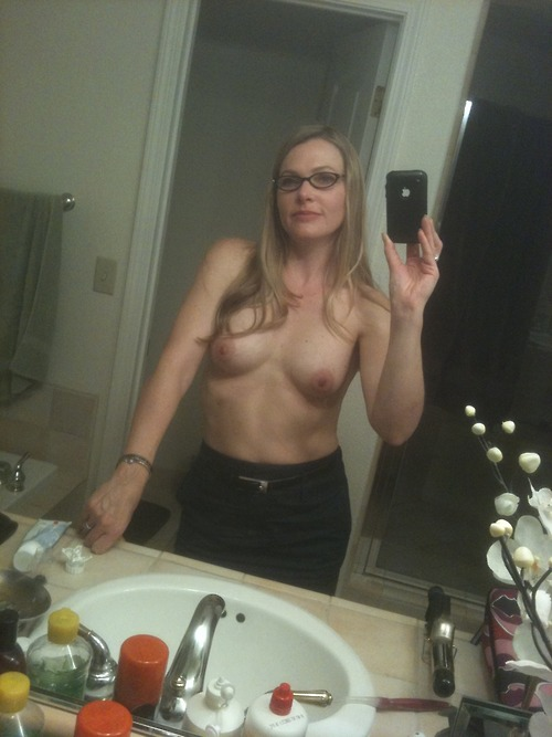 Blonde MILF with glasses selfshot in bathroom