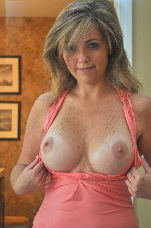 Wife likes to show her her big fake tits