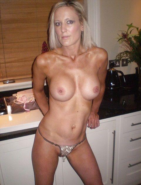 Hot blonde wife shot wearing nothing but thong