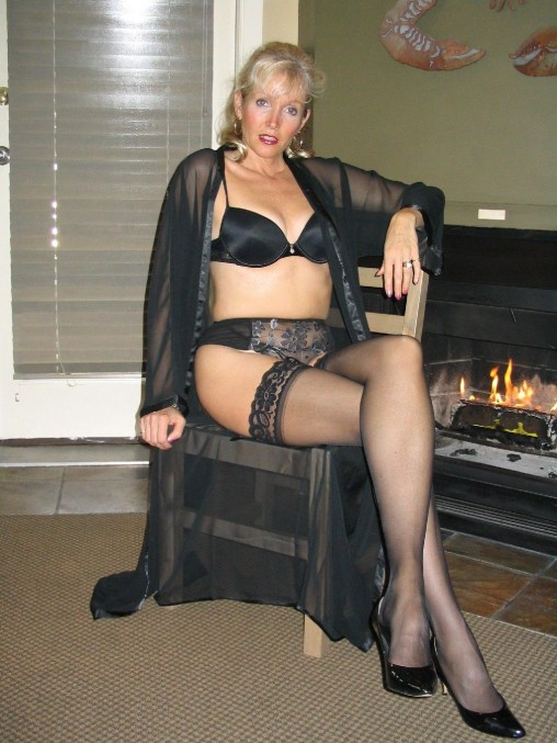 Busty milf in stockings a bra and sexy high heels 6