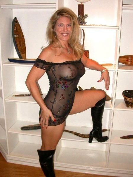 Happy MILF in seetrough dress and leather boots