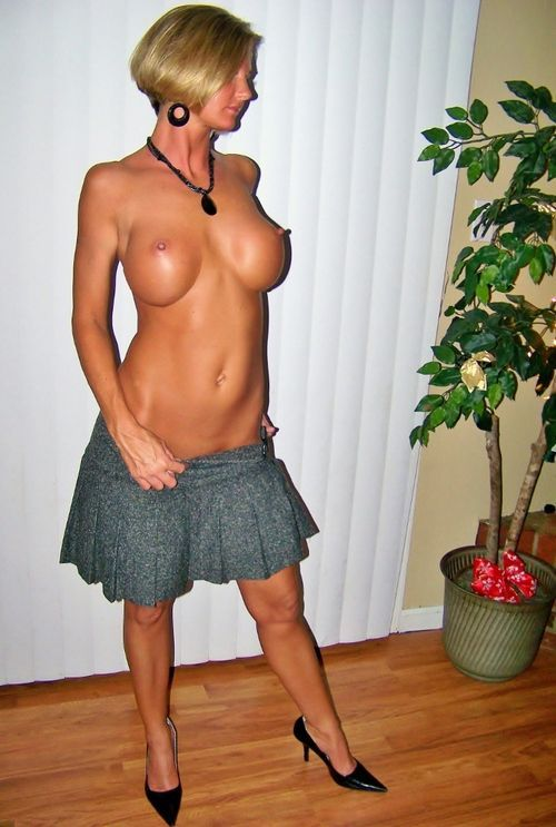MILF with pumped-up tits topless