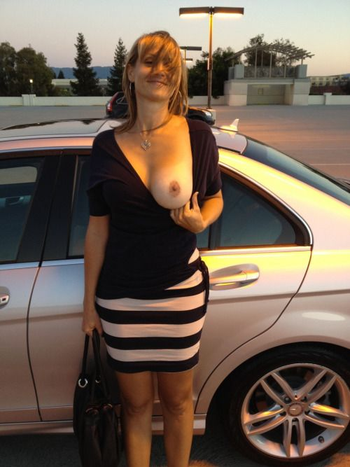 Hot MILF flashing her tit at the parking lot – MILF Update