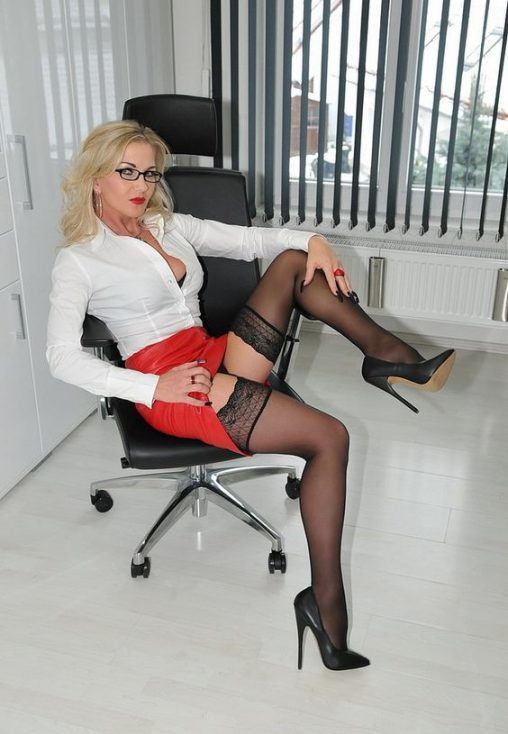 german-milf-secretary-in-sexy-red-miniskirt-nylons-and-heels